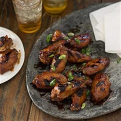BBQ Chicken Wings Recipe and Video - This yummy honey barbeque sauce is great on chicken wings, pork or short ribs. The soy sauce and oyster sauce hint at an Asian inspiration, while the gin gives it an undeterminable edge.