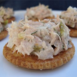 Tuna Fish Salad  Recipe -  A bit of parsley, a smidgen of garlic powder, a splash of lemon juice, and of course, tuna, celery, onion, and mayonnaise. This is a great tuna salad that works for a sandwich, stuffed into a plump tomato, or spooned onto fresh salad greens.