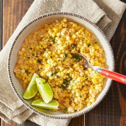 Mexican Spiced Corn Packets Recipe - Fresh corn off the cob is grilled in foil packets with a creamy, cheesy sauce,a hint of heat, and a bright lime note.