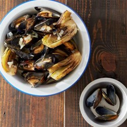 Grilled Mussels with Smoked Paprika Cream Recipe - Fresh mussels, fennel, white wine and cream are steamed in a large foil packet on the grill for an easy and delicious  summer seafood meal.