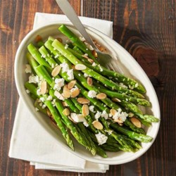 Honey Almond Asparagus with Feta Cheese Course Recipe - Sweet honey and salty feta bring out the bright flavor of asparagus in this delightful side that's cooked on the grill in  foil packets.