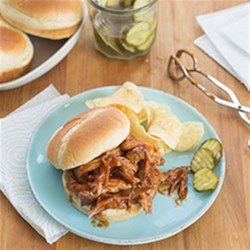 BBQ Pork Sandwiches Recipe - A combination of roasting, then barbecuing with sauce makes this pork a delicious southern style recipe. Takes some preparation but well worth it. Excellent for feeding a crowd!