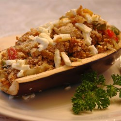 Summer Nights Eggplants Recipe - Eggplant is stuffed with sauteed eggplant, onion, peppers and bread crumbs, then topped off with some feta cheese and baked. I named it after the long summer nights I spent with my family on the balcony eating this tasty recipe, because at this season in Greece we have plenty of eggplants and cook them in various ways.