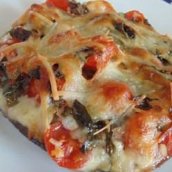 Gluten-Free Portobello Pizza Recipe - Portobello mushrooms layered with mozzarella cheese, tomato, and basil are a gluten-free version of pizza that is quick to prepare.