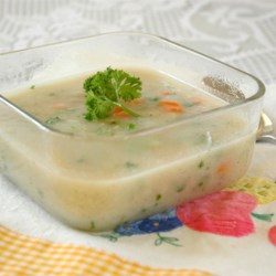 Smooth Cauliflower Soup Recipe - Cauliflower is cooked with nutmeg and garlic, then pureed and combined with carrots, green onion and parsley.