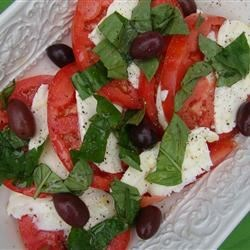 Tomozzakala Salad Recipe - What's an Italian summer without this? Tomato, fresh mozzarella, kalamata olives, and fresh basil salad.