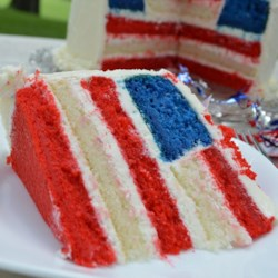 American Flag Cake Recipe - Unfurl the red, white, and blue with this beautiful, easy, and patriotic flag cake perfect for the 4th of July, Memorial Day, or any favorite occasion. Assemble and frost the pretty cake and wait for the oohs and ahhs!