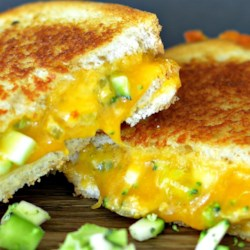 Sneak-Em In Grilled Cheese Sandwich Recipe - Grilled cheese with broccoli, zucchini, and green bell peppers is an easy way to add veggies to your family's diet and still have a nice comfort-food taste.