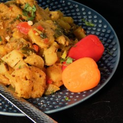 Caribbean Potato Curry Recipe - Take a cruise with this vegetarian curry recipe featuring a mixture of plantains, potatoes, bok choy, and broccoli to wake your taste buds and make you feel like you're in the Caribbean.