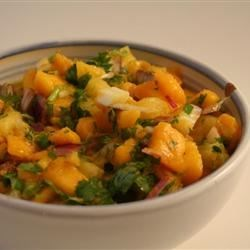 Mango Salsa Recipe - Colorful, spicy mango salsa has pineapple, cilantro leaves, red onion, and a kick of ginger and crushed red pepper.