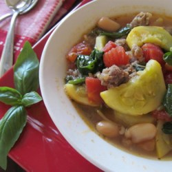 Tuscan Bean, Chicken, and Italian Sausage Soup Recipe - Using canned beans and tomatoes helps make a quick Italian-style soup featuring spinach and chicken sausage in this fairly simple recipe.