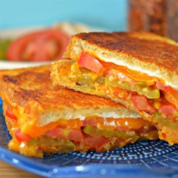 Best, Unique Grilled Cheese Recipe - Cheddar cheese and cream cheese with a garlic-vinegar-based sauce are layered between bread in this unique and delicious grilled cheese sandwich.