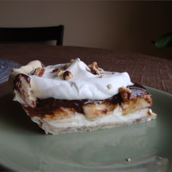 Chocolate Banana Pie Recipe - Pecans stud the pie crust. Then there 's a sweetened cream cheese layer, a whipped cream layer, a sliced banana layer, a chocolate layer, more bananas, and finally, more whipped cream. And, of course, more pecans are sprinkled over the top.