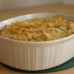 Tuna Noodle Casserole II Recipe - Pasta combined with tuna, mushroom and celery soups; layered with American cheese, topped with crushed potato chips and baked until bubbly and slightly browned.