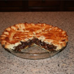 Simple Raisin Pie Recipe - Raisins are first plumped in a mixture of water, sugar, flour, vanilla, lemon juice and butter. Then the filling is poured into a prepared pastry crust, topped with another crust and baked. Serve it with scoops of rum raisin ice cream.