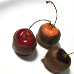 Chocolate Dipped Bing Cherries Recipe - Fresh sweet Bing cherries, infused with vanilla and dipped in dark chocolate. Best if eaten fresh but can be frozen for weeks in a covered tin.