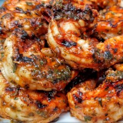 Marinated Grilled Shrimp Recipe and Video - Grilled shrimp are quickly marinated in a spiced tomato sauce, then grilled--either indoors or out. A big hit with company, and easy to prepare.