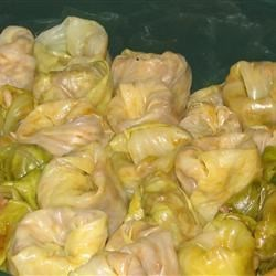 Sarmale (Stuffed Cabbage or Vine Leaves) Recipe - Cabbage is stuffed with rice, pork and vegetables in these classic cabbage rolls. This recipe is a very traditional Moldovan recipe.  My mother and my grandmother used to cook it at almost every Moldovan holy day and sometimes on a casual day. I love it!