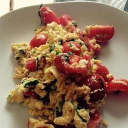 Chef John's Summer Scrambled Eggs Recipe - Chef John's recipe for summery scrambled eggs features cherry tomatoes, feta cheese, and plenty of fresh basil.