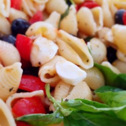 """Pasta Fredda Recipe - Pasta fredda, also known as """"cold pasta"""", includes pasta tossed with tomatoes, olives, and fresh mozzarella for a light, Italian-inspired meal."""