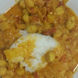 Chana Masala (Chickpeas and Tomatoes) Recipe - Chana masala, an Indian-inspired dish, contains chickpeas and tomatoes simmered in a nicely spiced coconut sauce. Serve with jasmine rice.