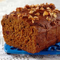 Cranberry Pumpkin Bread Recipe - An easy quick bread with plenty of zing, this pumpkin bread features nuts, orange zest and the tartness of whole berry cranberry sauce mixed in.