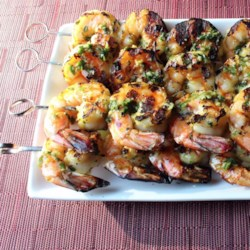 Chef John's Grilled Garlic and Herb Shrimp Recipe - A variety of fresh herbs and crushed garlic are used in both the marinade and the serving sauce in Chef John's grilled garlic and herb shrimp--a summer classic!