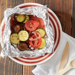 Grilled Italian Vegetables Recipe - Foil packets of chopped garden veggies with olive oil, lemon juice, and herbs are grilled until just tender for an easy summer side dish.