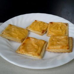 Oven-Baked Cheese Crackers Recipe - Oven-baked cheese crackers are a great recipe to make with kids and are a quick and easy snack to make any time of the day.