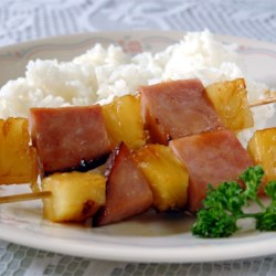 Ham and Pineapple Kabobs Recipe - Cooked ham and pineapple chunks threaded on skewers and coated with a zesty, sweet glaze.