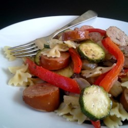 Sausage Stir Fry with Bow Tie Pasta Recipe - Bow-tie pasta is tossed in a nicely seasoned tomato-based sauce loaded with vegetables and sausage creating a filling meal the whole family will love.