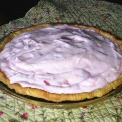 Strawberry Pie I Recipe - For this unique recipe, marshmallows are first melted in milk, and then strawberries are stirred into the creamy mixture. This wonderful concoction is then folded into freshly whipped cream and spooned into a baked pie shell. Chill for six hours before serving.