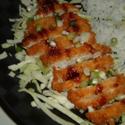 Ashley's Chicken Katsu with Tonkatsu Sauce Recipe - Panko (Japanese bread crumbs) crusted fried chicken breasts with a sweet Tonkatsu dipping sauce. Serve with your choice of steamed white rice, shredded cabbage, or even mashed potatoes.