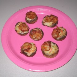 Seafood Stuffed Mushrooms Recipe - You chill this seafood medley for an hour before stuffing--flavors intensify and ingredients hold together nicely.