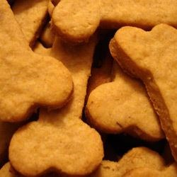 Dog Treats I Recipe - Cut-out dog biscuits with rolled oats, cornmeal and cheddar cheese. You can change the flavor of these by substituting chicken bouillon for the beef.