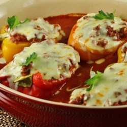 Lasagna Pepper Boats Recipe - Green bell peppers stuffed with cottage cheese, ground beef, tomato sauce, and cheese are a gluten-free version of lasagna.