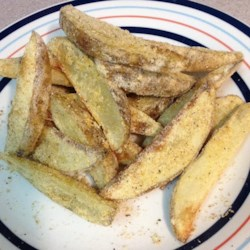 Rosemary Baked Potato Wedges Recipe - These oven-baked potato wedges come with a crunch.