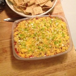 "5 Layer Mexican Dip Recipe - Nothing says ""football snacks"" like a Mexican-style layered dip. This one has just five layers: beans, guacamole, sour cream, cheese, and tomatoes."