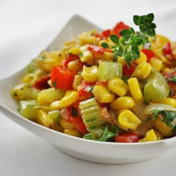 Melody's Corn Maque Choux Recipe - Tender kernels of sweet corn cook with bacon, red and green bell peppers, and plenty of garlic in this traditional Creole side dish.