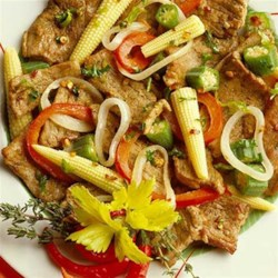 Dixie Pork Stir-Fry Recipe - Seasoned strips of pork loin filet and quickly stir fried with onion, bell pepper, baby corn, and okra in this Southern-inspired one-pan dinner.