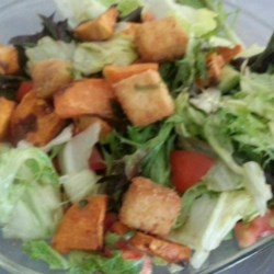 Amazing Crunchy Tofu Salad Recipe - Tofu cubes are marinated in soy sauce and lemon, then breaded and fried creating a crunchy and flavorful component to this mixed salad.