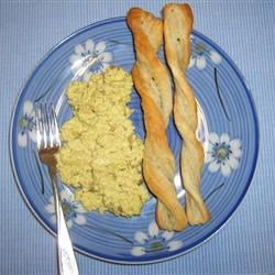 Creamy Curried Scrambled Eggs Recipe - A different twist on comfort food for breakfast.  Cream cheese added to the eggs makes them extra-decadent, while the curry and shallots make them extra-savory.  Delicious served on warmed plates with toast on a cold Seattle morning!