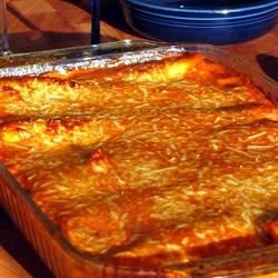 Italian Baked Cannelloni Recipe - A savory, creamy, cheesy meat filling is stuffed into pasta shells and topped with a homemade tomato sauce for a delicious special-occasion dinner.