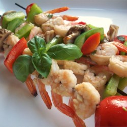 Garlic Balsamic Shrimp Recipe - Shrimp in a balsamic vinegar marinade, cooked with onions and peppers on a pan grill.