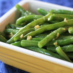Deluxe Garlic Green Beans Recipe - Green beans are steamed in the microwave, dressed with a few simple ingredients, and ready to serve in just a few minutes.