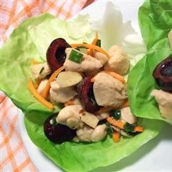 Cherry Chicken Lettuce Wraps Recipe - Teriyaki chicken never had it so good in this intriguing mixture with cherries, ginger, rice vinegar, carrots and almonds, all bundled up in a crisp lettuce package.