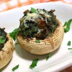 Stuffed Mushrooms with Spinach Recipe - Large mushrooms are stuffed with a savory spinach, bacon and Parmesan cheese mixture, then baked until golden brown.