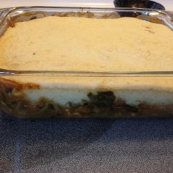 Vegetable Shepherd's Pie with Baked Beans Recipe - A unique combination of Indian flavors and baked beans replace the usual ground beef in this vegetarian shepherd's pie.