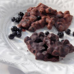 Chocolate Blueberry Bark Recipe - Blueberry chocolate bark is quick and easy to make using two simple ingredients: milk chocolate and dried blueberries.