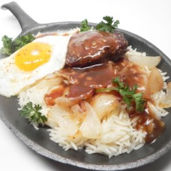 Mauigirl's Loco Moco Recipe - Serve a taste of Hawaiian loco moco for breakfast - rice topped with a burger patty and fried onions, and brown gravy is topped with a fried egg.
